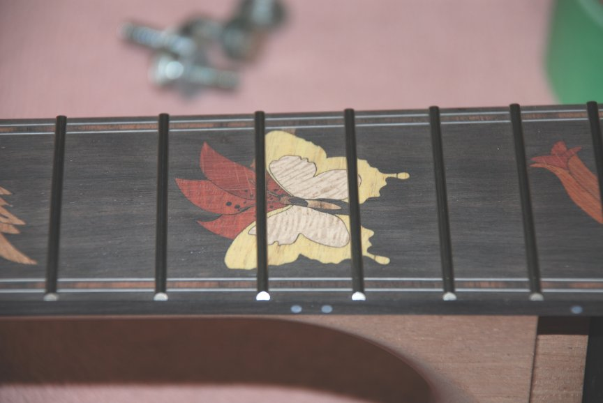 Laser Cut wood inlaid in Custom Guitar